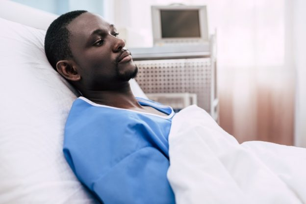man in a hospital bed