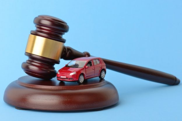 toy car next to a gavel