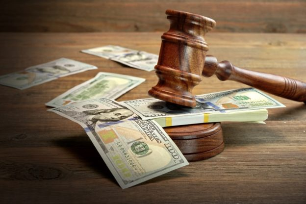 stack of money under a gavel